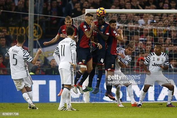 Juventus' Bosnian midfielder Miralem Pjanic scores during the Italian Serie A football match Genoa vs Juventus on November 27 2016 at the Luigi...