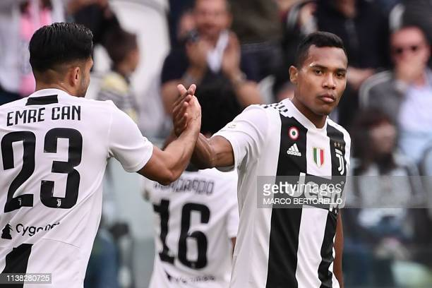 Juventus' Brazilian defender Alex Sandro celebrates with Juventus' German midfielder Emre Can after scoring an equalizer during the Italian Serie A...