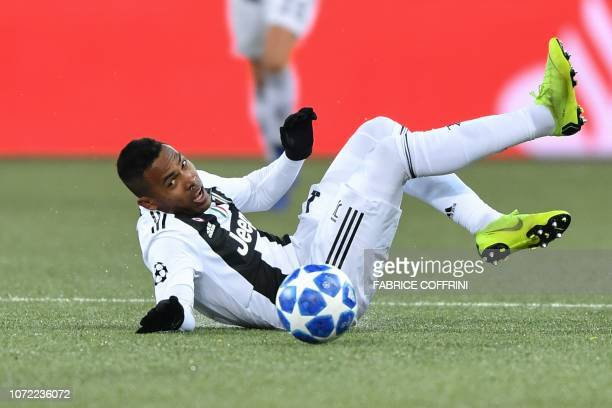 Juventus' Brazilian defender Alex Sandro falls during the UEFA Champions League group H football match between Young Boys and Juventus at the Stade...