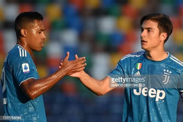 Juventus' Brazilian defender Alex Sandro highfives Juventus' Argentinian forward Paulo Dybala during the Italian Serie A football match between...
