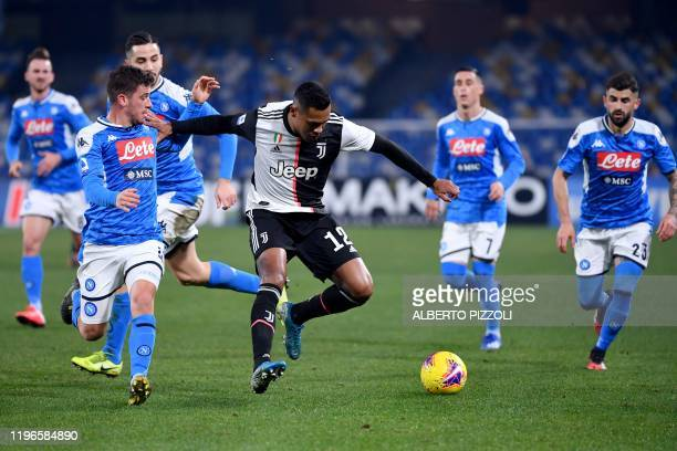 Juventus' Brazilian defender Alex Sandro holds off Napoli's German midfielder Diego Demme during the Italian Serie A football match Napoli vs...