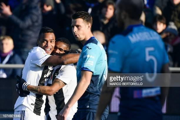 Juventus' Brazilian defender Alex Sandro l and Juventus' Brazilian forward Douglas Costa celebrate after Atalanta scored an own goal during the...