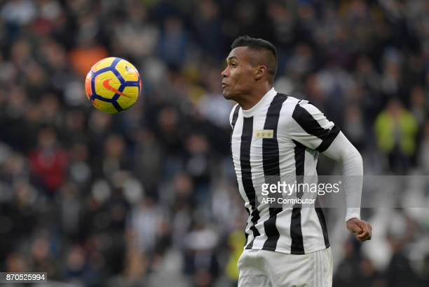 Juventus' Brazilian defender Alex Sandro Lobo Silva controls the ball during the Italian Serie A football match Juventus vs Benevento at the Juventus...