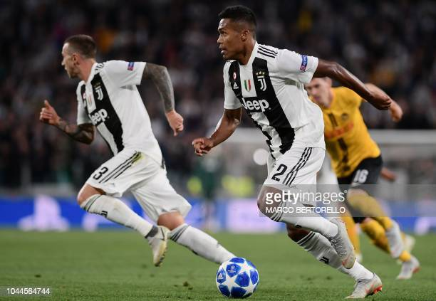 Juventus' Brazilian defender Alex Sandro runs with the ball during the UEFA Champions League group H football match between Juventus and Young Boys...