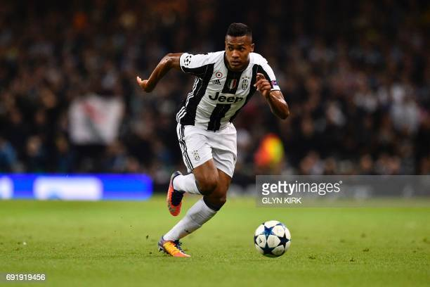 Juventus' Brazilian defender Alex Sandro runs with the ball during the UEFA Champions League final football match between Juventus and Real Madrid at...