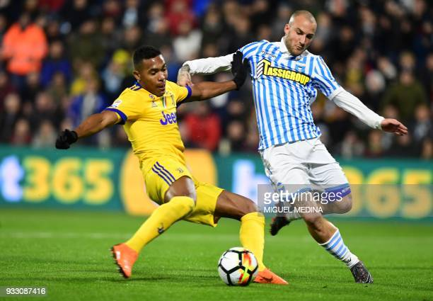 Juventus' Brazilian defender Alex Sandro vies with Spal's Italian defender Filippo Costa during the Italian Serie A football match Spal vs Juventus...