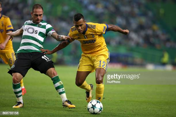 Juventus' Brazilian defender Alex Sandro vies with Sporting's midfielder Bruno Cesar from Brazil during the UEFA Champions League football match...