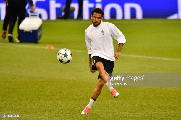 Juventus' Brazilian defender Dani Alves attends a training session at The Principality Stadium in Cardiff on June 2 on the eve of the UEFA Champions...