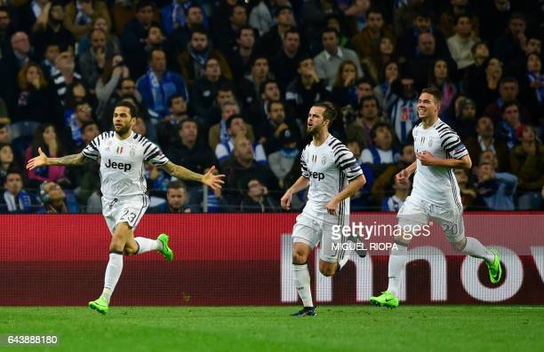 Juventus' Brazilian defender Dani Alves celebrates with teammates Bosnian midfielder Miralem Pjanic and Croatian forward Marko Pjaca after scoring a...