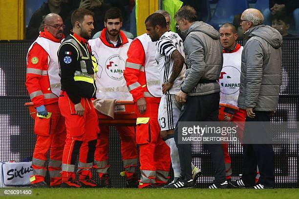 Juventus' Brazilian defender Daniel Alves leaves the pitch after being injured during the Italian Serie A football match Genoa vs Juventus on...