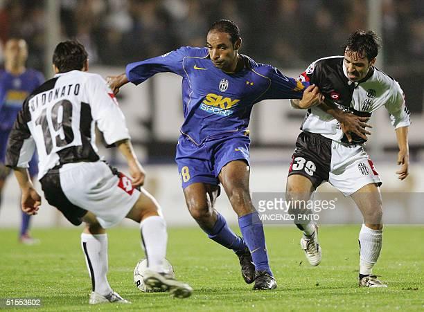 Juventus' Brazilian Emerson Da Rosa Ferreira fights for the ball with Daniele DI Donato and Fabio Pecchia of Siena during their Italian Serie A...