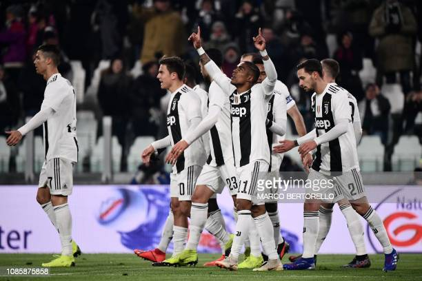 Juventus' Brazilian forward Douglas Costa celebrates after opening the scoring during the Italian Serie A football match Juventus vs Chievo Verona on...
