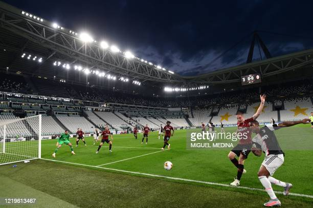 Juventus' Brazilian forward Douglas Costa challenges AC Milan's Italian defender Andrea Conti during the Italian Cup semifinal second leg football...