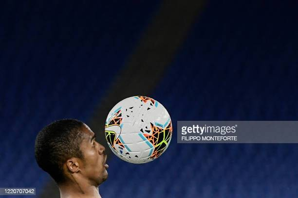 Juventus' Brazilian forward Douglas Costa eyes the ball during the TIM Italian Cup final football match Napoli vs Juventus on June 17 2020 at the...