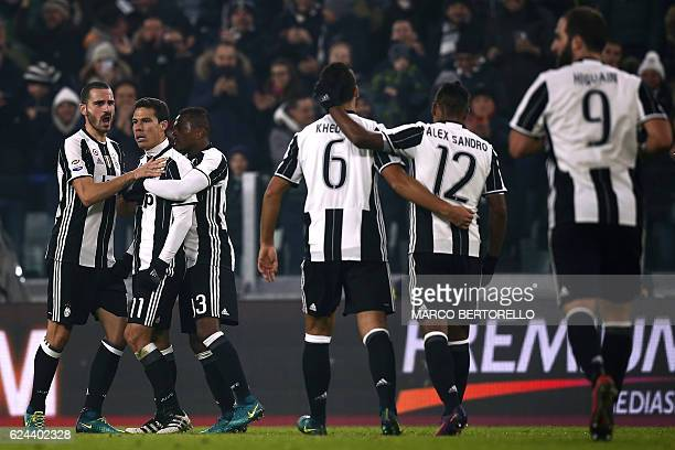Juventus' Brazilian midfielder Anderson Hernanes celebrates with teammates after scoring a goal during the Italian Serie A football match between...