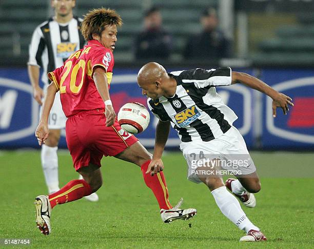 Juventus Brazilian midfielder Ruben Olivera vies with Messina's Japanese opponent Athsushi Yanagisawa during their Serie A football match at delle...