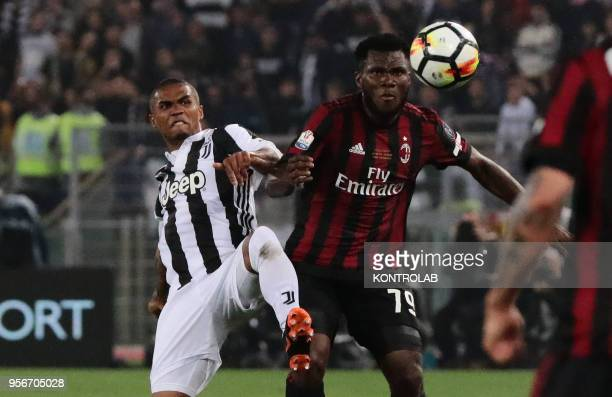 Juventus' Brazilian striker Douglas Costa fights for the ball with Milan's Ivorian midfielder Franck Kessie during the Tim Italy Cup Final football...