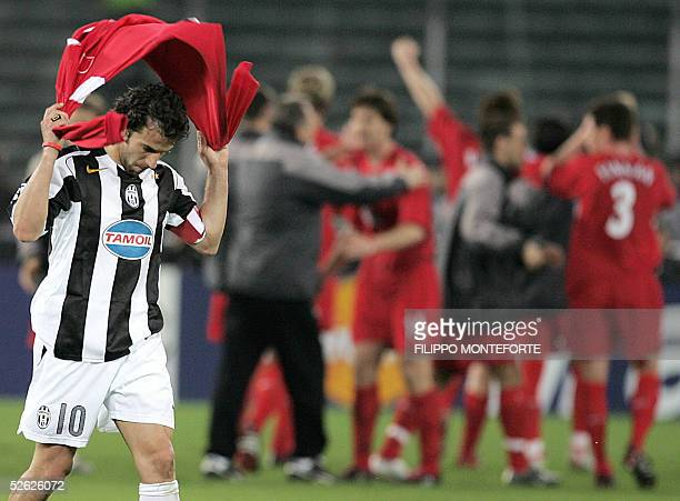 Juventus captain Alex Del Piero walks away from the pitch as Liverpool player jubilate at the end of Champion's League quarter final second leg...