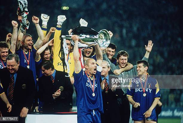 Juventus captain Gianluca Vialli holds the cup aloft after his team beat AFC Ajax to win the UEFA Champions League Final at the Stadio Olimpico Rome...