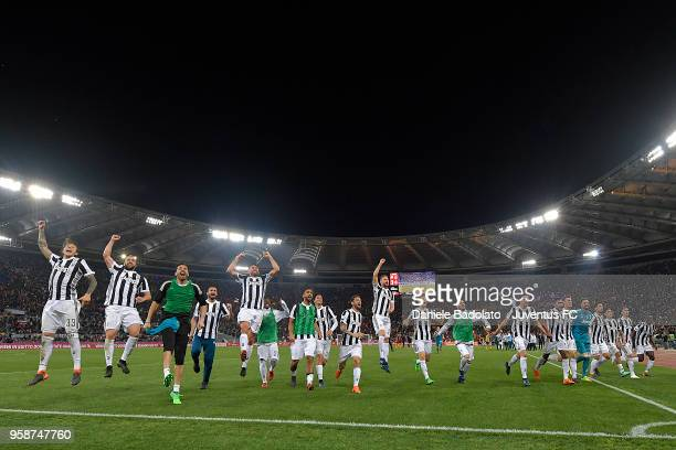 Juventus celebrate during the serie A match between AS Roma and Juventus at Stadio Olimpico on May 13 2018 in Rome Italy