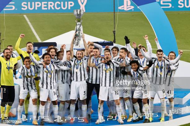 Juventus Celebrates with the Italian Supercup during the Italian Super Cup match between Juventus v Napoli at the Allianz Stadium on January 20, 2021...