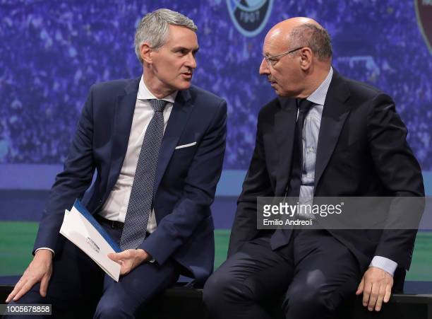 Juventus CEO Giuseppe Marotta speaks with FC Internazionale CEO Alessandro Antonello during the Serie A 2018/19 Fixture unveiling on July 26 2018 in...