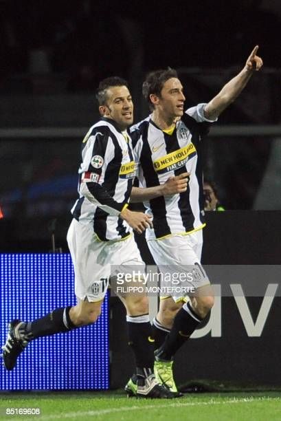 Juventus' Claudio Marchisio celebrates with teammate Alex Del Piero after scoring against Napoli during their Series A football match at Turin's...