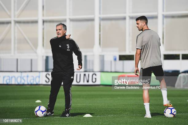Juventus coach Aldo Dolcetti and player Leonardo Spinazzola during a training session at JTC on October 12 2018 in Turin Italy