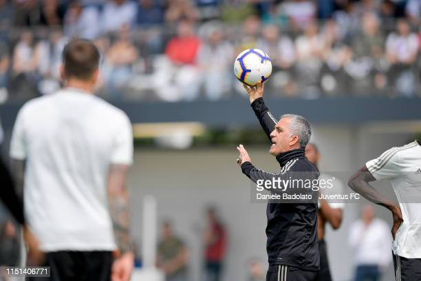 Juventus coach Aldo Dolcetti handles a ball during a training session at JTC on May 24 2019 in Turin Italy