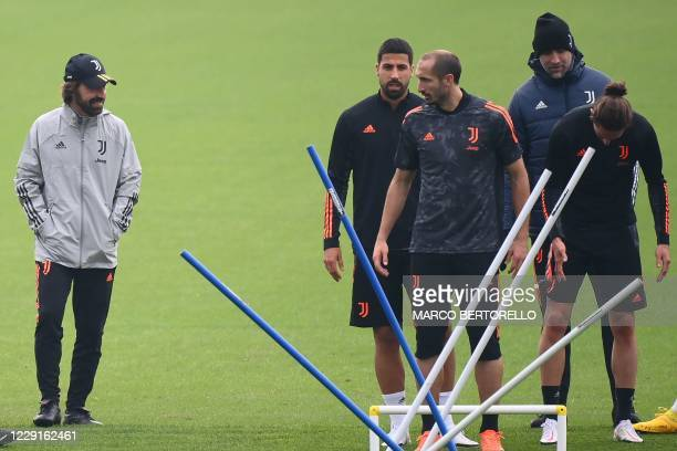 Juventus coach Andrea Pirlo from Italy and Juventus midfielder Sami Khedira from Germany Juventus defender Giorgio Chiellini attend the training...