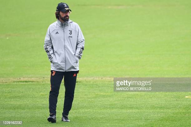 Juventus' coach Andrea Pirlo from Italy attends the training session at the Juventus Training Center in Turin on the eve of the UEFA Champions League...