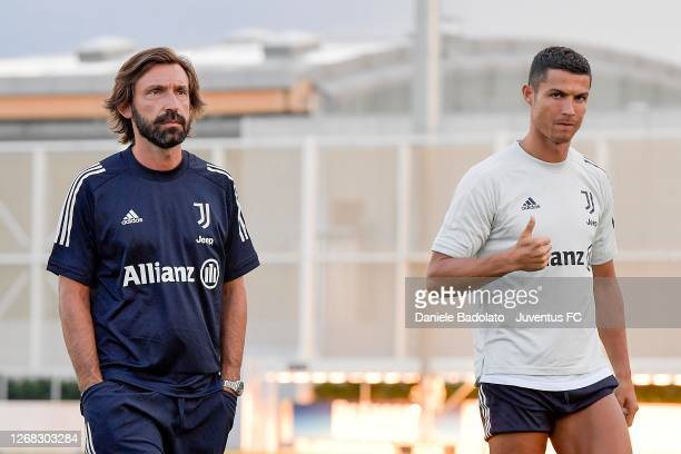Juventus coach Andrea Pirlo with player Cristiano Ronaldo attend a training session at JTC on August 24, 2020 in Turin, Italy.