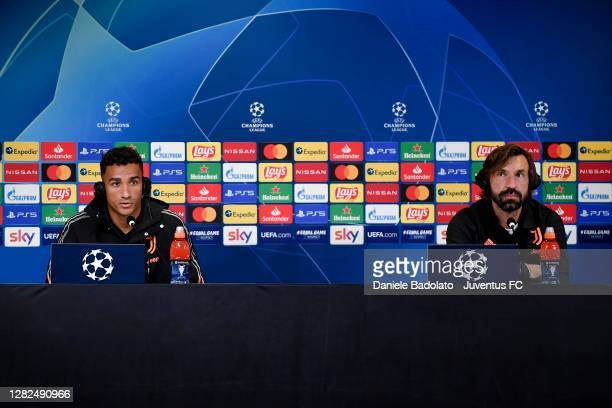 Juventus coach Andrea Pirlo with player Danilo during the UEFA Champions League press conference at Allianz Stadium on October 27 2020 in Turin Italy