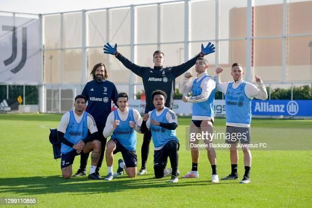 Juventus coach Andrea Pirlo with players Danilo, Alessandro Di Pardo, Weston McKennie, Wojciech Szczesny, Cristiano Ronaldo and Arthur during a...