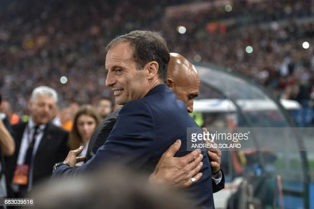 Juventus' coach from Italy Massimiliano Allegri hugs AS Roma's coach Luciano Spalletti before the Italian Serie A football match Roma vs Juventus on...