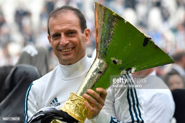 Juventus' coach from Italy Massimiliano Allegri poses with the trophy during the victory ceremony following the Italian Serie A last football match...