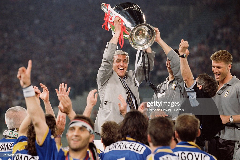 Juventus Coach Marcello Lippi Holds The Trophy After His