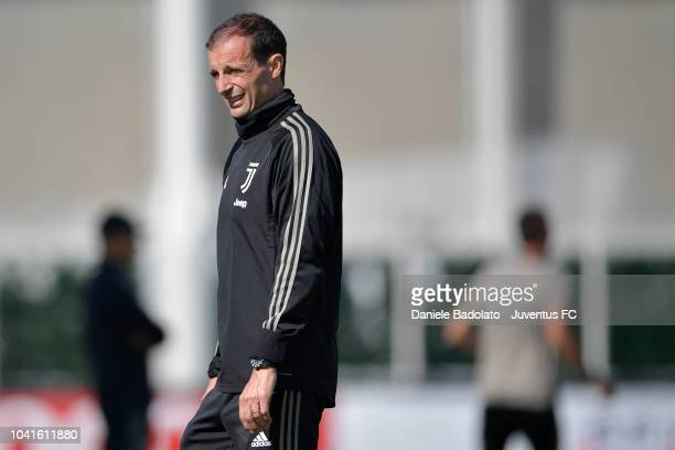 Juventus coach Massimiliano Allegri looks on during a training session at JTC on September 27 2018 in Turin Italy