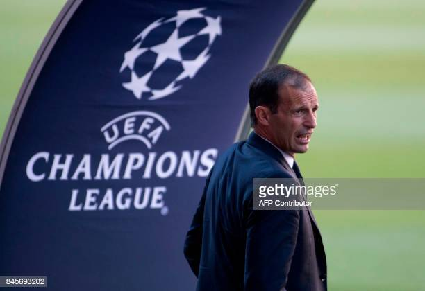 Juventus' coach Massimiliano Allegri looks on during a visit of the Camp Nou stadium in Barcelona on September 11 2017 on the eve of the UEFA...