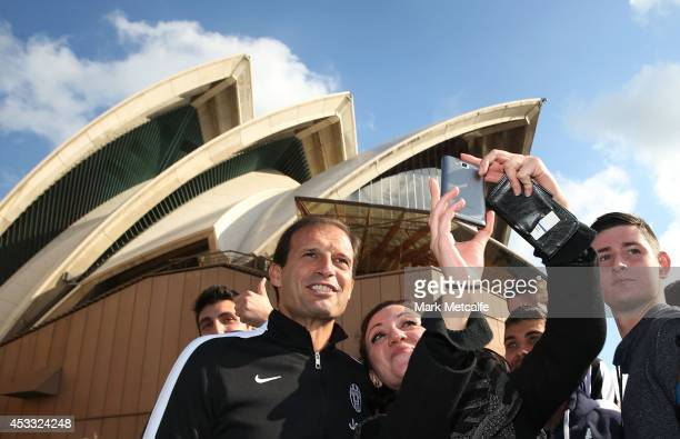 Juventus Coach Massimiliano Allegri poses for photos with fans in front of the Sydney Opera House during the Juventus media conference at Sydney...