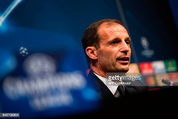 Juventus' coach Massimiliano Allegri speaks during a press conference at the Camp Nou stadium in Barcelona on September 11 2017 on the eve of the...