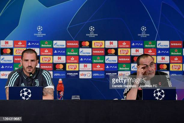 Juventus coach Maurizio Sarri and player Leonardo Bonucci during the press conference ahead the Champions League match between Juventus and Olympique...