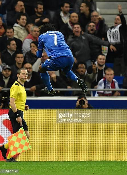 Juventus' Colombian forward Juan Cuadrado celebrates after scoring a goal during the Champions League football match between Olympique Lyonnais and...