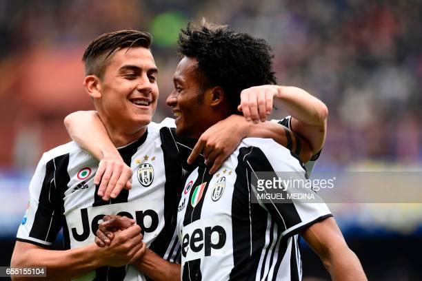 Juventus' Colombian forward Juan Cuadrado celebrates with Juventus' Argentinian forward Paulo Dybala after scoring a goal during the Italian Serie A...