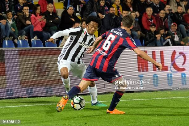 Juventus' Colombian forward Juan Guillermo Cuadrado challenges Crotone's Swedish midfielder Marcus Rohden during the Italian Serie A football match...