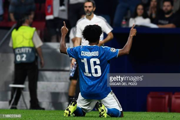 Juventus' Colombian midfielder Juan Cuadrado celebrates after scoring a goal during the UEFA Champions League Group D football match between Atletico...
