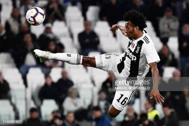 TOPSHOT Juventus' Colombian midfielder Juan Cuadrado jumps for the ball during the Italian Serie A football match between Juventus and Torino on May...