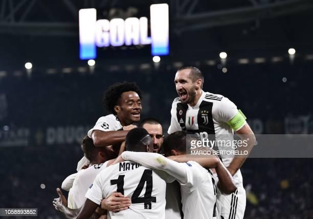 Juventus' Colombian midfielder Juan Cuadrado Juventus' Italian defender Giorgio Chiellini and teammates celebrate after Juventus' Portuguese forward...