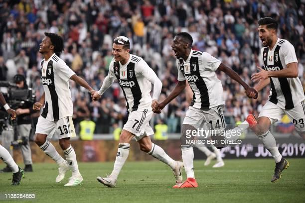 Juventus' Colombian midfielder Juan Cuadrado Juventus' Portuguese forward Cristiano Ronaldo Juventus' French midfielder Blaise Matuidi and Juventus'...