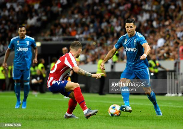 Juventus' Cristiano Ronaldo controls the ball in front of Atletico Madrid's Kieran Trippier during the International Champions Cup football match...